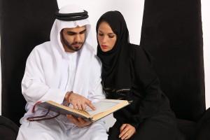 Arabian Couple Reading Islamic Text